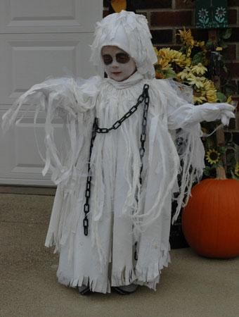 this is my 3 year old grandson carter who wanted to be spooky ghost since it is always so cold here in minnesota i needed to make his costume fit over