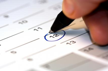 A circled date on a calendar indicating when an individual's period should begin