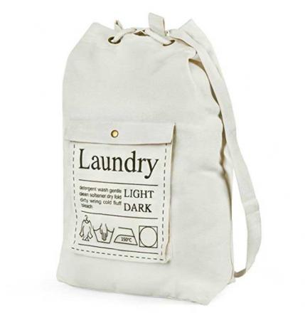 Canvas laundry bag with shoulder straps and front pocket for detergent
