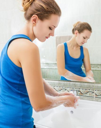 Woman washing her hands in the restroom
