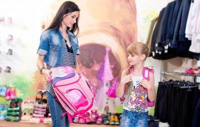 mom and daughter out for shopping to go back to school